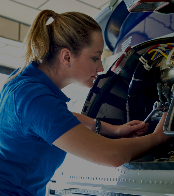Woman doing aircraft maintenance