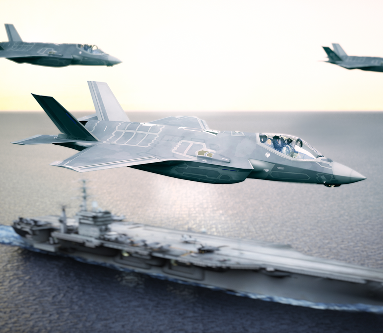 F-35 jets flying over aircraft carrier